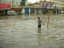 creative commons image of child walking through flood waters